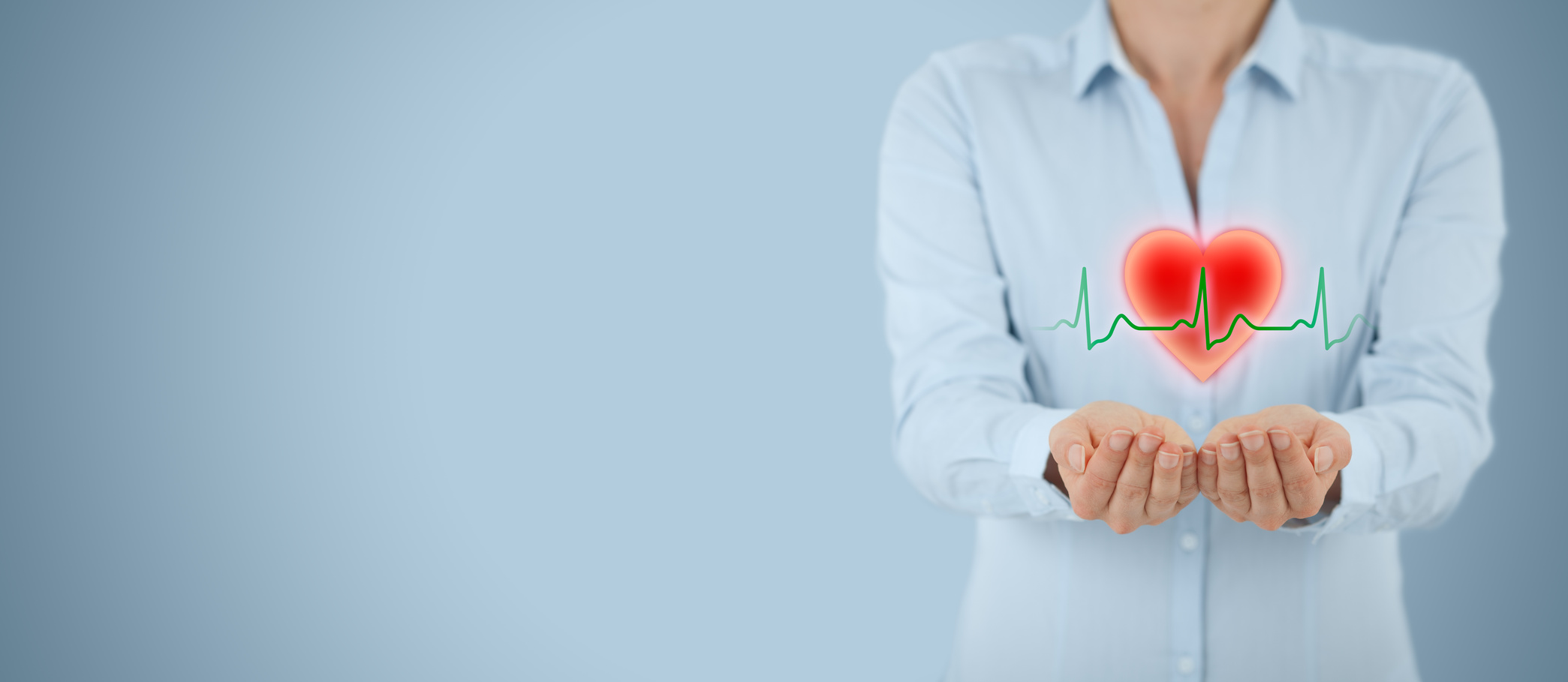 Protect health (healthcare) and heart problems prevention (cardiology) concept. Cardiologist with protective gesture and symbol of heart and ECG heartbeat, wide banner composition.